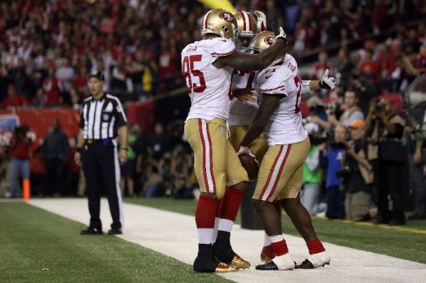 Vernon Davis, Colin Kaepernick, and Frank Gore during the NFC Championship