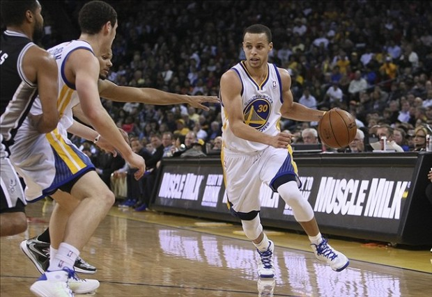 April 15, 2013; Oakland, CA, USA; Golden State Warriors point guard Stephen Curry (30) drives in with the screen by shooting guard Klay Thompson (11) against the San Antonio Spurs during the second quarter at Oracle Arena. Mandatory Credit: Kelley L Cox-USA TODAY Sports