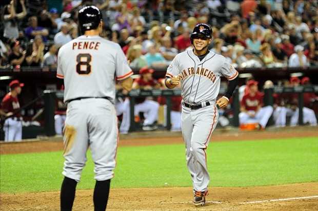 May 1, 2013; Phoenix, AZ, USA; San Francisco Giants right fielder Gregor Blanco (7) celebrates with right fielder Hunter Pence (8) after scoring on a 3 run home run by first baseman Brandon Belt (9) during the eighth inning against the Arizona Diamondbacks at Chase Field. Mandatory Credit: Matt Kartozian-USA TODAY Sports