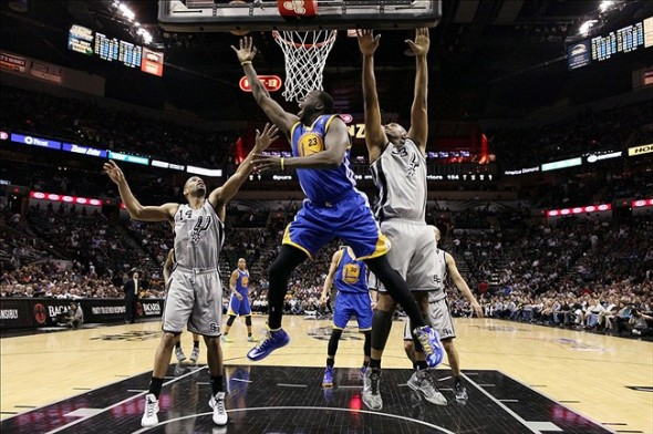 May 6, 2013; San Antonio, TX, USA; Golden State Warriors forward Draymond Green (23) drives to the basket past San Antonio Spurs forward Boris Diaw (33) during game one of the second round of the 2013 NBA Playoffs at the AT&T Center. The Spurs won 129-127 in overtime. Mandatory Credit: Soobum Im-USA TODAY Sports
