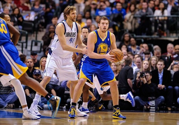Feb 9, 2013; Dallas, TX, USA; Dallas Mavericks power forward Dirk Nowitzki (41) guards Golden State Warriors power forward David Lee (10) during the game at the American Airlines Center. The Mavericks defeated the Warriors 116-91. Mandatory Credit: Jerome Miron-USA TODAY Sports