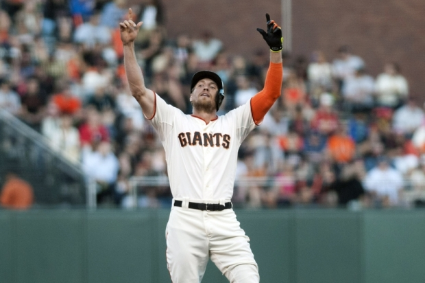 May 13, 2014; San Francisco, CA, USA; San Francisco Giants right fielder Hunter Pence (8) points to the sky after hitting a double against the Atlanta Braves during the first inning at AT&T Park. Mandatory Credit: Ed Szczepanski-USA TODAY Sports