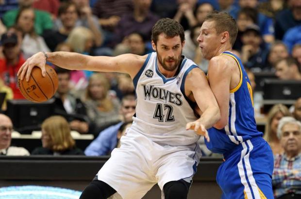 Nov 6, 2013; Minneapolis, MN, USA; Golden State Warriors power forward David Lee (10) plays tight defense on Minnesota Timberwolves power forward Kevin Love (42) as he attempts to drive to the basket in the first half at Target Center. Mandatory Credit: Jesse Johnson-USA TODAY Sports