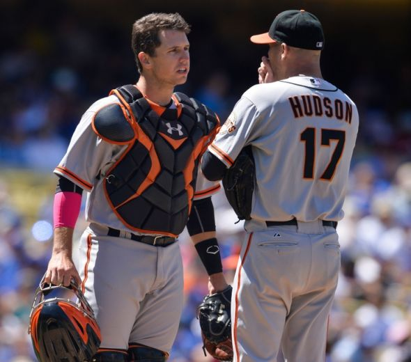 May 11, 2014; Los Angeles, CA, USA; San Francisco Giants catcher Buster Posey (28) and San Francisco Giants starting pitcher Tim Hudson (17) at the mound in the 5th inning against the Los Angeles Dodgers at Dodger Stadium. Mandatory Credit: Robert Hanashiro-USA TODAY Sports