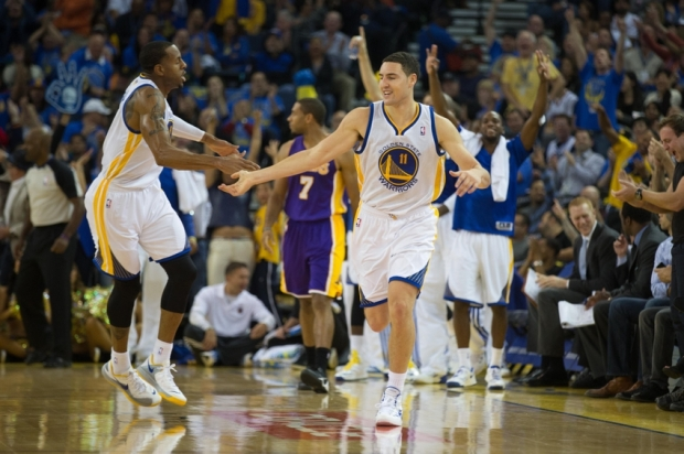 Oct 30, 2013; Oakland, CA, USA; Golden State Warriors shooting guard Klay Thompson (11) celebrates with shooting guard Andre Iguodala (9) after a basket against the Los Angeles Lakers during the second quarter at Oracle Arena. Mandatory Credit: Kelley L Cox-USA TODAY Sports