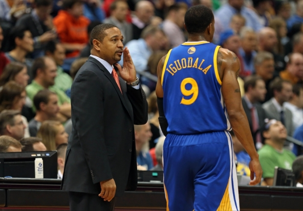 Nov 6, 2013; Minneapolis, MN, USA; Golden State Warriors head coach Mark Jackson talks to shooting guard Andre Iguodala (9) in the second half against the Minnesota Timberwolves at Target Center. The Warriors won 106-93. Mandatory Credit: Jesse Johnson-USA TODAY Sports