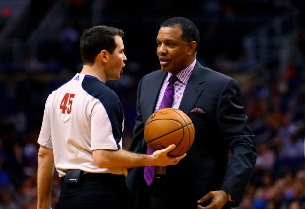 Mar 4, 2014; Phoenix, AZ, USA; Los Angeles Clippers assistant coach Alvin Gentry (right) talks with NBA referee Brian Forte during the game against the Phoenix Suns at the US Airways Center. Mandatory Credit: Mark J. Rebilas-USA TODAY Sports