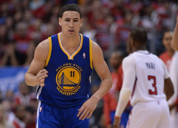 Apr 19, 2014; Los Angeles, CA, USA; Golden State Warriors guard Klay Thompson (11) heads down court after a 3-point basket in the second half of game one of the first round of the 2014 NBA Playoffs at Staples Center. Warriors won 109-105. Mandatory Credit: Jayne Kamin-Oncea-USA TODAY Sports