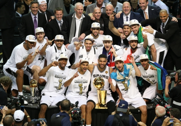 Jun 15, 2014; San Antonio, TX, USA; San Antonio Spurs pose for a photo with the Larry O'Brien trophy after the game against the Miami Heat in game five of the 2014 NBA Finals at AT&T Center. The Spurs defeated the Heat 104-87 to win the NBA Finals. Mandatory Credit: Soobum Im-USA TODAY Sports