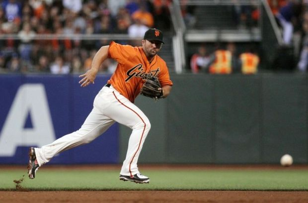 Jul 25, 2014; San Francisco, CA, USA; San Francisco Giants second baseman Dan Uggla (22) chases a ground ball in the fourth inning of their MLB baseball game with the Los Angeles Dodgers at AT&T Park. Mandatory Credit: Lance Iversen-USA TODAY Sports