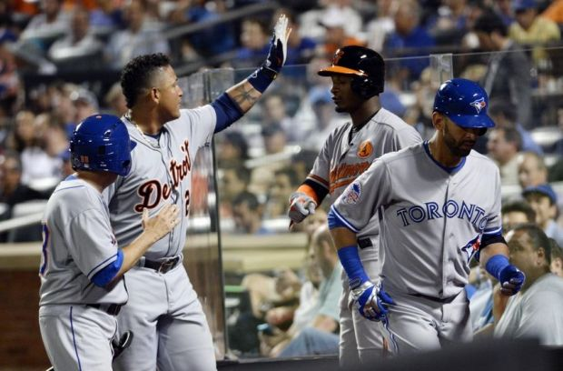 Jul 16, 2013; Flushing, NY, USA; American League infielder Miguel Cabrera (24) of the Detroit Tigers celebrates after scoring on a sacrifice fly by outfielder Jose Bautista (right) of the Toronto Blue Jays in the 2013 All Star Game at Citi Field. Mandatory Credit: Robert Deutsch-USA TODAY Sports