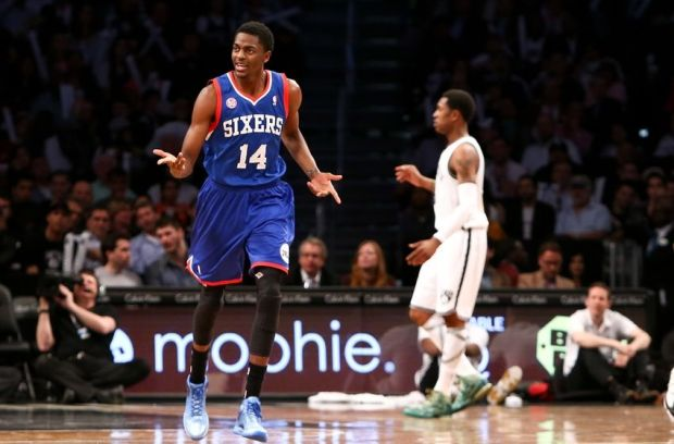 Apr. 9, 2013; Brooklyn, NY, USA; Philadelphia 76ers shooting guard Justin Holiday (14) reacts on the court against the Brooklyn Nets during the second half at Barclays Center. Nets won 104-83. Mandatory Credit: Debby Wong-USA TODAY Sports