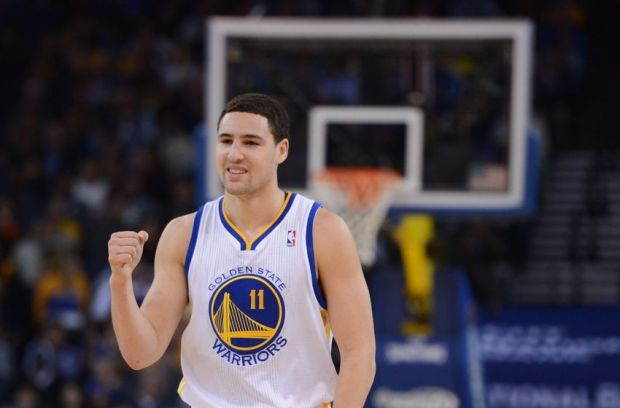 December 17, 2013; Oakland, CA, USA; Golden State Warriors shooting guard Klay Thompson (11) celebrates after a play against the New Orleans Pelicans during the first quarter at Oracle Arena. Mandatory Credit: Kyle Terada-USA TODAY Sports