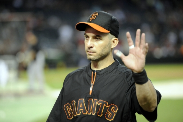 Jun 21, 2014; Phoenix, AZ, USA; San Francisco Giants second baseman Marco Scutaro (19) waves to fans before facing the Arizona Diamondbacks at Chase Field. Mandatory Credit: Joe Camporeale-USA TODAY Sports