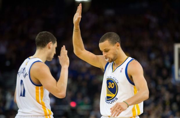 Mar 20, 2014; Oakland, CA, USA; Golden State Warriors guard Stephen Curry (30) high fives guard Klay Thompson (11) after the basket and one against the Milwaukee Bucks during the fourth quarter at Oracle Arena. The Golden State Warriors defeated the Milwaukee Bucks 115-110. Mandatory Credit: Kelley L Cox-USA TODAY Sports
