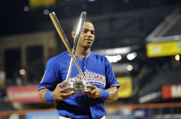 Jul 15, 2013; Flushing , NY, USA; American League player Yoenis Cespedes of the Oakland Athletics poses with the trophy after winning the Home Run Derby in advance of the 2013 All Star Game at Citi Field. Mandatory Credit: Robert Deutsch-USA TODAY Sports