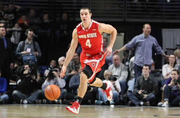 Feb 27, 2014; University Park, PA, USA; Ohio State Buckeyes guard Aaron Craft (4) dribbles the ball up court during the second half against the Penn State Nittany Lions at Bryce Jordan Center. Penn State defeated Ohio State 65-63. Mandatory Credit: Matthew O