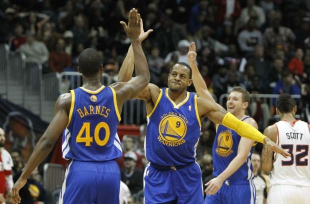 Jan 3, 2014; Atlanta, GA, USA; Golden State Warriors small forward Harrison Barnes (40) shows emotion with small forward Andre Iguodala (9) against the Atlanta Hawks in the fourth quarter at Philips Arena. The Warriors defeated the Hawks 101-100. Mandatory Credit: Brett Davis-USA TODAY Sports