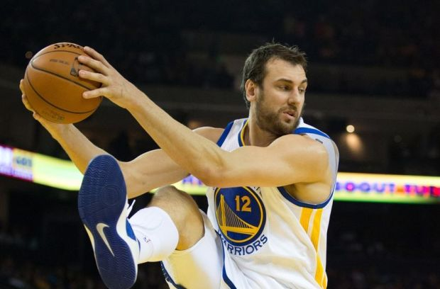 Mar 14, 2014; Oakland, CA, USA; Golden State Warriors center Andrew Bogut (12) controls a rebound against the Cleveland Cavaliers during the second quarter at Oracle Arena. Mandatory Credit: Kelley L Cox-USA TODAY Sports