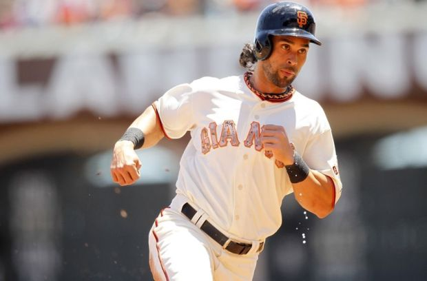 May 26, 2014; San Francisco, CA, USA; San Francisco Giants outfielder Angel Pagan (16) prepares to round third base before scoring a run against the Chicago Cubs in the first inning at AT&T Park. Mandatory Credit: Cary Edmondson-USA TODAY Sports