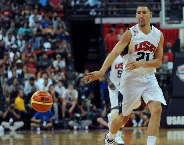 Aug 1, 2014; Las Vegas, NV, USA; USA Team White guard Klay Thompson (21) passes the ball during the USA Basketball Showcase at Thomas & Mack Center. Mandatory Credit: Stephen R. Sylvanie-USA TODAY Sports