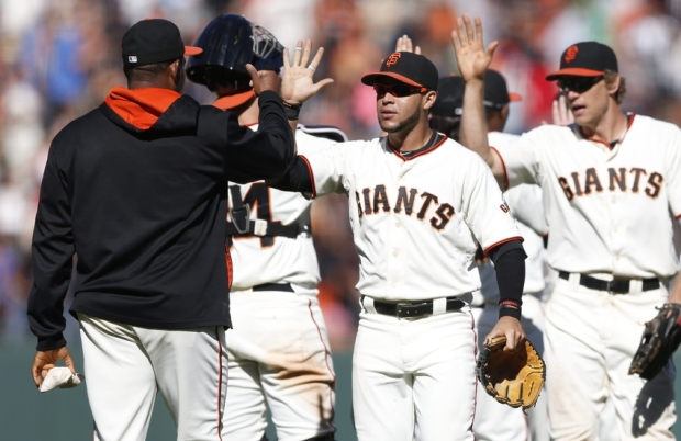 Aug 31, 2014; San Francisco, CA, USA; San Francisco Giants outfield comes in to celebrate with rest of team after the final out of the game against the Milwaukee Brewers at AT&T  Park. Giants won 15 to 5. Mandatory Credit: Bob Stanton-USA TODAY Sports