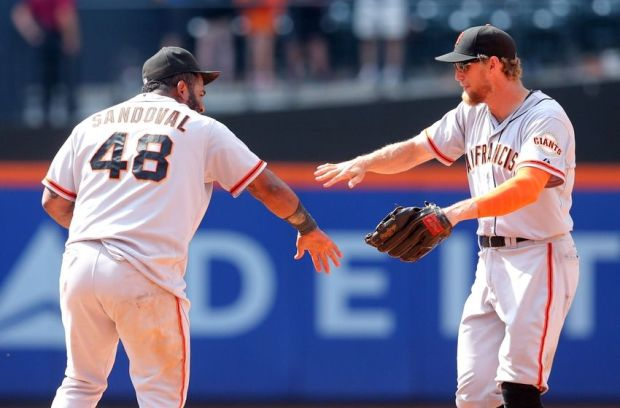 Aug 4, 2014; New York, NY, USA; San Francisco Giants third baseman Pablo Sandoval (48) celebrates with right fielder Hunter Pence (8) after defeating the New York Mets after the ninth inning of a game at Citi Field. Mandatory Credit: Brad Penner-USA TODAY Sports