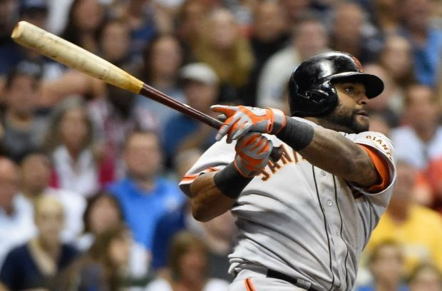 Aug 5, 2014; Milwaukee, WI, USA; San Francisco Giants third baseman Pablo Sandoval (48) hits a 3-run homer in the sixth inning against the Milwaukee Brewers at Miller Park. Mandatory Credit: Benny Sieu-USA TODAY Sports