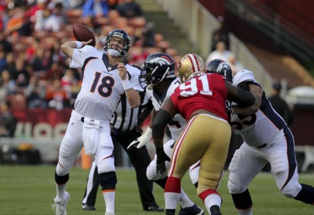 Aug 8, 2013; San Francisco, CA, USA; Denver Broncos quarterback Peyton Manning (18) throws the ball against the San Francisco 49ers during the first quarter at Candlestick Park. Mandatory Credit: Kelley L Cox-USA TODAY Sports