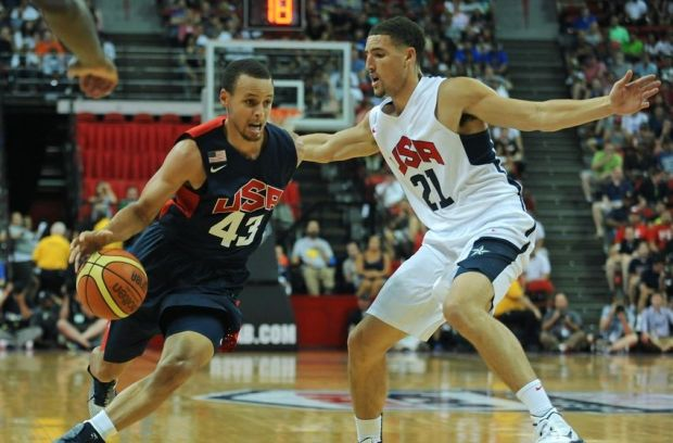 Aug 1, 2014; Las Vegas, NV, USA; USA Team Blue guard Stephen Curry (43) dribbles the ball into the lane against the defense of USA Team White guard Klay Thompson (21) during the USA Basketball Showcase at Thomas & Mack Center. Mandatory Credit: Stephen R. Sylvanie-USA TODAY Sports