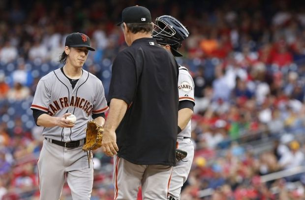 Aug 23, 2014; Washington, DC, USA; San Francisco Giants manager Bruce Bochy (R) removes Giants starting pitcher Tim Lincecum (55) from the game against the Washington Nationals in the third inning at Nationals Park. The Nationals won 6-2. Mandatory Credit: Geoff Burke-USA TODAY Sports