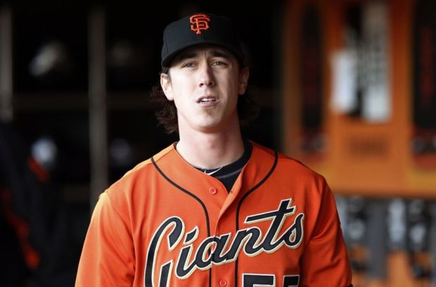 Jul 11, 2014; San Francisco, CA, USA; San Francisco Giants starting pitcher Tim Lincecum (55) look across the field from the Giants dugout before the game against the Arizona Diamondbacks at AT&T Park. Mandatory Credit: Bob Stanton-USA TODAY Sports