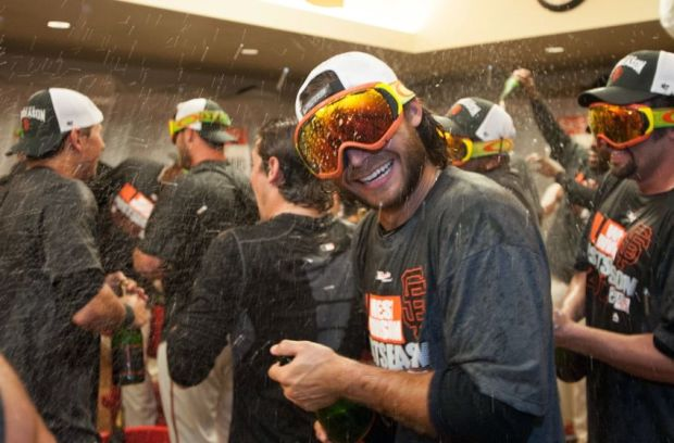 Sep 25, 2014; San Francisco, CA, USA; San Francisco Giants shortstop Brandon Crawford (35) celebrates with team mates after clinching the National League wild card at AT&T Park. The San Francisco Giants defeated the San Diego Padres 9-8. Mandatory Credit: Ed Szczepanski-USA TODAY Sports