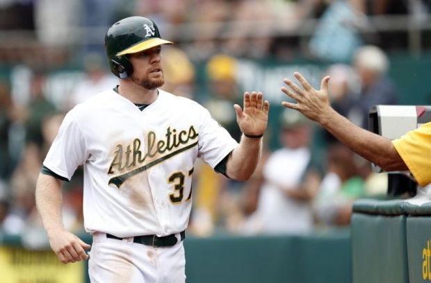 Sep 21, 2014; Oakland, CA, USA; Oakland Athletics left fielder Brandon Moss (37) is congratulated after he scored  in the fifth inning against the Philadelphia Phillies at O.co Coliseum. Mandatory Credit: Bob Stanton-USA TODAY Sports