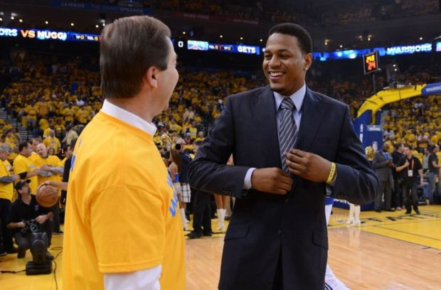 May 2, 2013; Oakland, CA, USA; Golden State Warriors owner Joe Lacob (left) talks with shooting guard Brandon Rush (4, right) before game six of the first round of the 2013 NBA Playoffs against the Denver Nuggets at Oracle Arena. Mandatory Credit: Kyle Terada-USA TODAY Sports