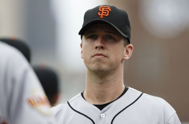 Sep 6, 2014; Detroit, MI, USA; San Francisco Giants catcher Buster Posey (28) in the dugout before the game against the Detroit Tigers at Comerica Park. Mandatory Credit: Rick Osentoski-USA TODAY Sports