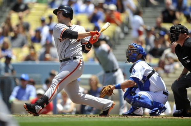 May 10, 2014; Los Angeles, CA, USA; San Francisco Giants first baseman Buster Posey (28) hits a single in the first inning against the Los Angeles Dodgers at Dodger Stadium. Mandatory Credit: Gary Vasquez-USA TODAY Sports