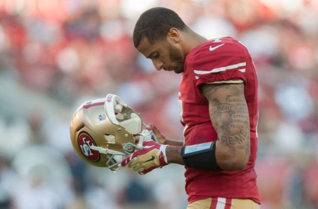 Sep 14, 2014; Santa Clara, CA, USA; San Francisco 49ers quarterback Colin Kaepernick (7) looks on during the second quarter of the game against the Chicago Bears at Levi's Stadium. The Chicago Bears defeated the San Francisco 49ers 28-20. Mandatory Credit: Ed Szczepanski-USA TODAY Sports