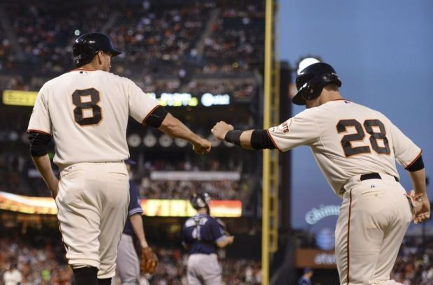 April 29, 2014; San Francisco, CA, USA; San Francisco Giants right fielder Hunter Pence (8) and first baseman Buster Posey (28) celebrate after both scored on a two-RBI single by catcher Hector Sanchez (29, not pictured) against the San Diego Padres during the third inning at AT&T Park. Mandatory Credit: Kyle Terada-USA TODAY Sports
