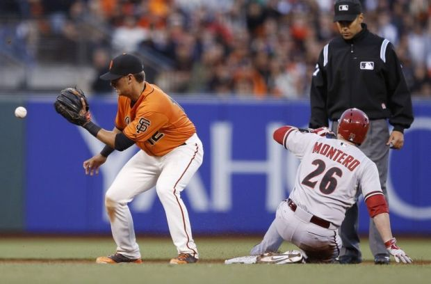 Jul 11, 2014; San Francisco, CA, USA; San Francisco Giants second baseman Joe Panik (12) gets the ball too late as Arizona Diamondbacks catcher Miguel Montero (26) slides into second after hitting a double during the fourth inning at AT&T Park. Mandatory Credit: Bob Stanton-USA TODAY Sports