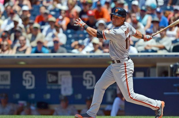Jul 6, 2014; San Diego, CA, USA; San Francisco Giants shortstop Joe Panik (12) hits an RBI double during the third inning against the San Diego Padres at Petco Park. Mandatory Credit: Jake Roth-USA TODAY Sports