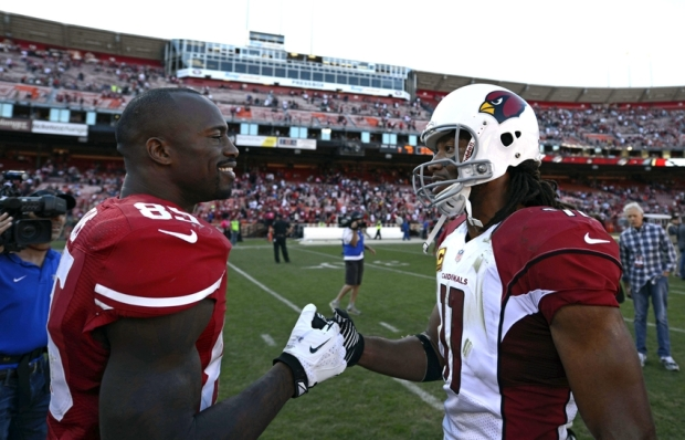 Oct 13, 2013; San Francisco, CA, USA; Arizona Cardinals wide receiver Larry Fitzgerald (11) and San Francisco 49ers tight end Vernon Davis (85) talk after the game on the field at Candlestick Park. San Francisco 49ers won 32-20.  Mandatory Credit: Bob Stanton-USA TODAY Sports