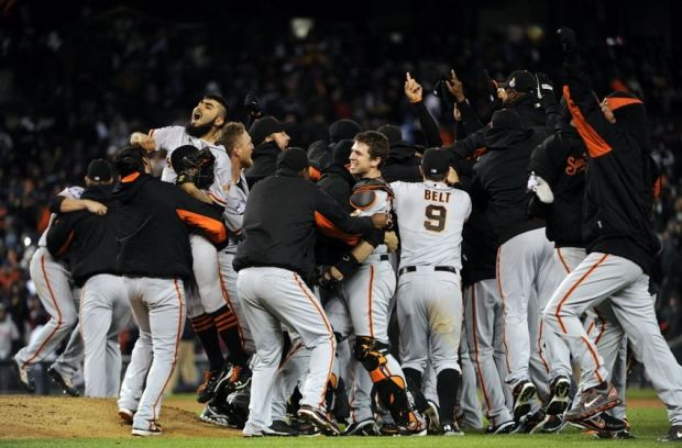 Oct 28, 2012; Detroit, MI, USA; Members of the San Francisco Giants celebrate on the field after game four of the 2012 World Series against the Detroit Tigers at Comerica Park.  The Giants won 4-3 to sweep the series. Mandatory Credit: H. Darr Beiser-USA TODAY Sports