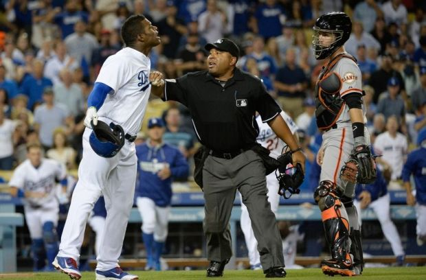 Sep 23, 2014; Los Angeles, CA, USA; Los Angeles Dodgers right fielder Yasiel Puig (66) yells at San Francisco Giants starting pitcher Madison Bumgarner (40) (not pictured) after Bumgarner hit Puig with a pitch during the first inning at Dodger Stadium. Mandatory Credit: Richard Mackson-USA TODAY Sports