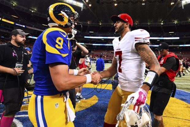 Oct 13, 2014; St. Louis, MO, USA; St. Louis Rams quarterback Austin Davis (9) and San Francisco 49ers quarterback Colin Kaepernick (7) meet at mid field after the game between the St. Louis Rams and the San Francisco 49ers at the Edward Jones Dome. The San Francisco 49ers defeat the St. Louis Rams 31-17. Mandatory Credit: Jasen Vinlove-USA TODAY Sports