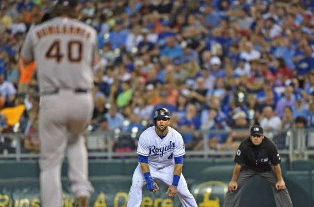 Aug 8, 2014; Kansas City, MO, USA; Kansas City Royals base runner Alex Gordon (4) takes a lead off first against San Francisco Giants pitcher Madison Bumgarner (40) during the fourth inning at Kauffman Stadium. Mandatory Credit: Peter G. Aiken-USA TODAY Sports