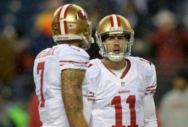Dec 23, 2012; Seattle, WA, USA; San Francisco 49ers quarterbacks Alex Smith (11) and Colin Kaepernick (7) react against the Seattle Seahawks at CenturyLink Field. Mandatory Credit: Kirby Lee/Image of Sport-USA TODAY Sports