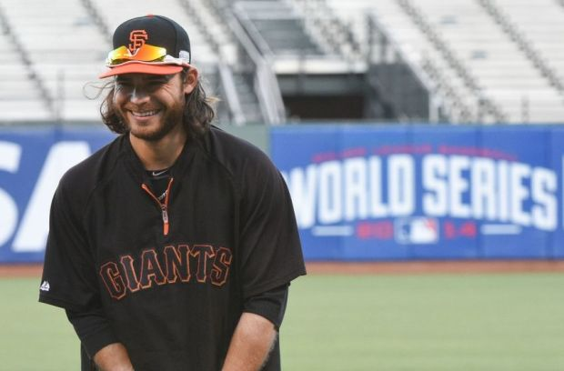 October 23, 2014; San Francisco, CA, USA; San Francisco Giants shortstop Brandon Crawford (35) smiles during workouts the day before game three of the 2014 World Series at AT&T Park. Mandatory Credit: Kyle Terada-USA TODAY Sports