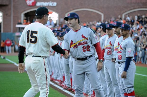 Oct 14, 2012; San Francisco, CA, USA; St. Louis Cardinals manager Mike Matheny (22) shakes hands with San Francisco Giants manager Bruce Bochy (15) before game one of the 2012 NLCS at AT&T Park.  Mandatory Credit: Jayne Kamin-Oncea-USA TODAY Sports