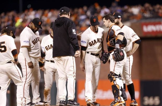 Oct 24, 2014; San Francisco, CA, USA; San Francisco Giants starting pitcher Tim Hudson (middle) is relieved by manager Bruce Bochy (in black) in the sixth inning against the Kansas City Royals during game three of the 2014 World Series at AT&T Park. Mandatory Credit: Kelley L Cox-USA TODAY Sports